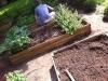 Joshua cleaning tasting garden