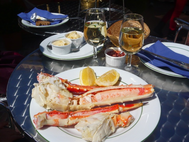 Plate of king crab legs and lemon garnish